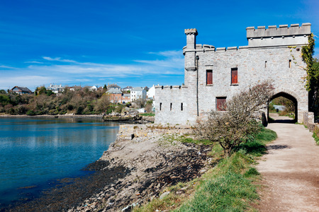 The 19th-century folly known as Radford Castle located on a dam separating the freshwater Radford Lake Plymstock Plymouth Devon England UK