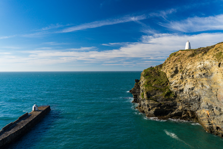 The cliffs and view over the harbour entrance at Portreath Cornwall England UK Europe