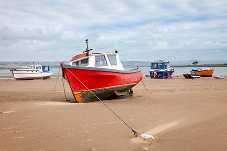 Boats on the beach at Crow Point Devon England UK