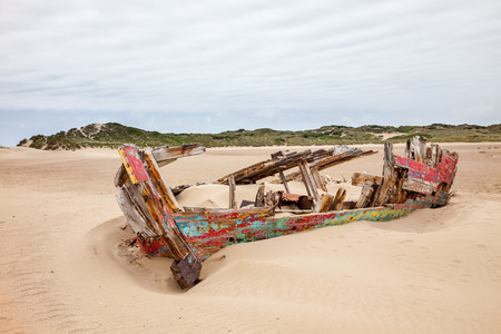 Ruined boat on the beach at Crow Point Devon England UK