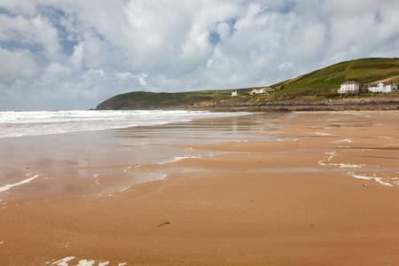 Dramatic stormy sky on the beautiful golden sandy beach at Croyde Beach Devon England Stock Photo