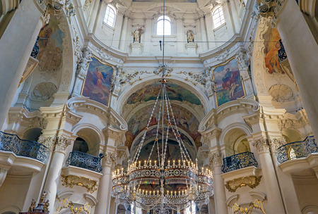 PRAGUE, CZECH REPUBLIC - 28th of July 2016 - Stunning interior and crystal crown chandelier in the Baroque St Nicholas Cathedral Old Town Prague, a popular tourist destination.