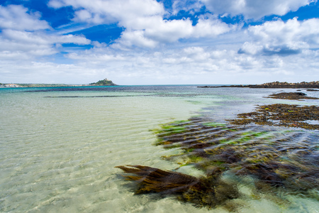 Long Rock Beachwith  Marazion and St Michaels Mount in the distance Cornwall England UK Europe
