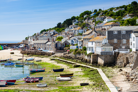 The beautiful village and harbour at Mousehole near Penzance Cornwall England UK Europe