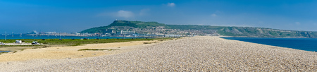 View along Chesil Beach near Weymouth towards the Isle of Portland Dorset England UK 写真素材