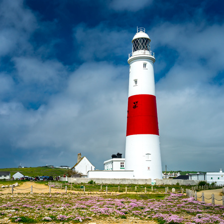 The red and white striped lighthouse at Portland Bill Dorset England UK Europe 版權商用圖片