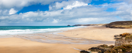 Panoramic shot of the golden sandy beach at  Perranporth Cornwall England UK Europe Фото со стока