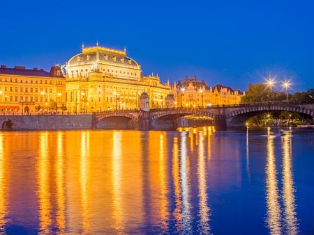 The National Theatre,  and River Vltava at dusk Prague Czech Republic Europe