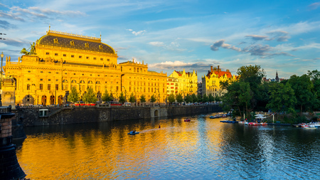 The National Theatre,  and River Vltava at sunset Prague Czech Republic Europe