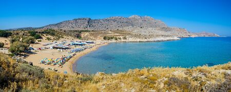 Panoramic shot overlooking the beautiful golden sandy Agathi Beach on the Dodecanese Island of Rhodes Greece