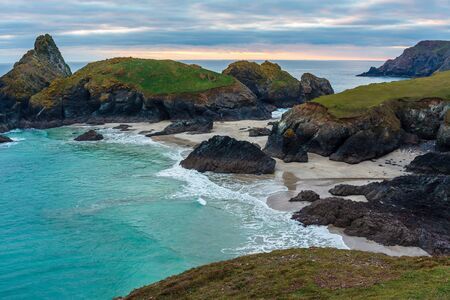 Sunset overlooking the beach at Kynance Cove Cornwall England UK