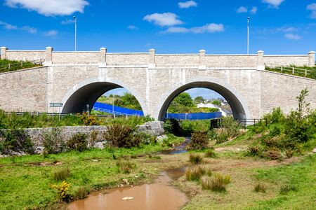 Bridge over the road and The red River at Tuckingmill near Camborne Cornwall UK Europe