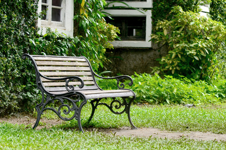 dingy: Wooden chair in garden on dingy light day