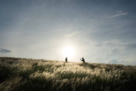 People looking for the happiness again after the COVID-19 situation is better in Thailand. By travelling to the meadow field for see the grass flowers field and watching the sunset