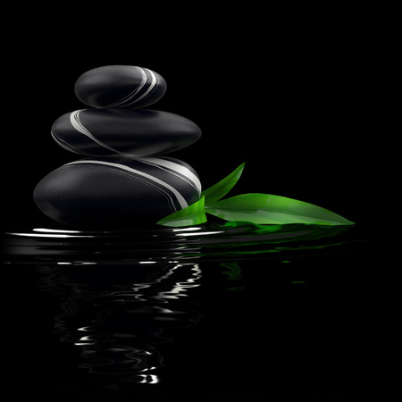 black stones: Spa stones and bamboo leaf in waters on black background.