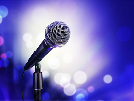 searchlights: microphone on a blue background in the rays of searchlights