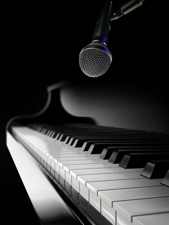 black piano: piano keys on black piano with microphone Stock Photo