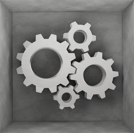 steel gear wheels in the grey box Stock Photo