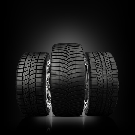 summer tires: three wheels with new tires on a black background
