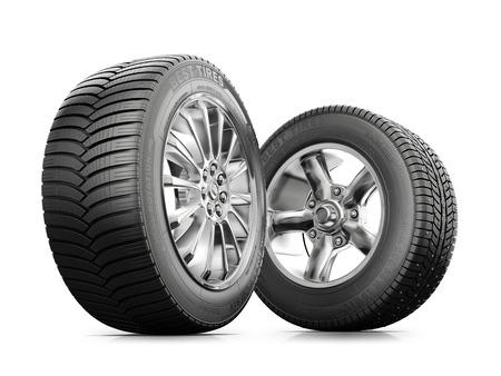 twee wielen met nieuwe banden die op een witte achtergrond Stockfoto