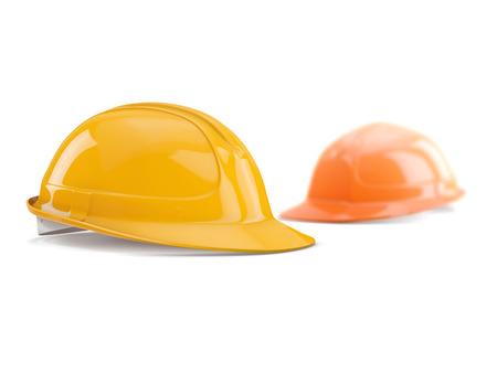 shallow: yellow and orange safety helmet on white background, shallow DOF