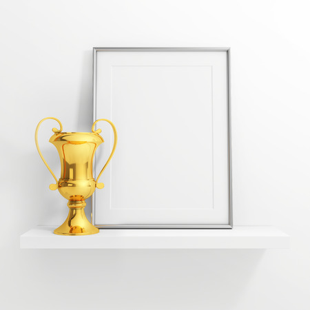 white shelf: gold cup and blank photo frame on white shelf on white background Stock Photo