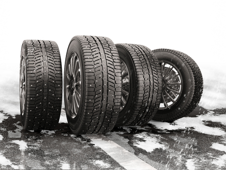 snow tires: Four car tires rolling on a snow-covered road. 3d illustration.