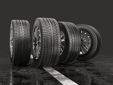 Four car tires rolling on a road on a gray background. 3d illustration. Stockfoto
