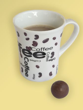 White cup filled with hot creamy black coffee photo