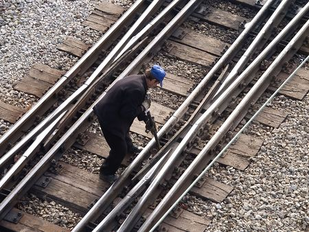 Railway switch and a worker
