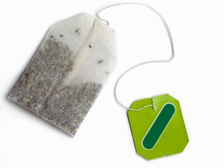 Tea bag on white photo