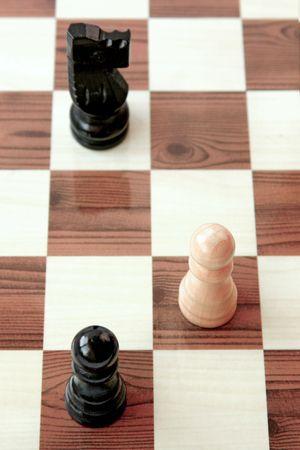 Chess, white pawn under attack Stock Photo - 3109054