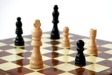 outwit: Chess pieces on board - white background