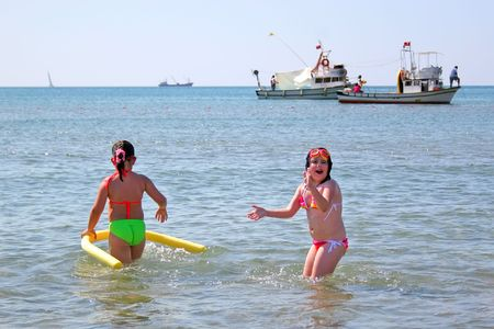 Girls playing at beach photo