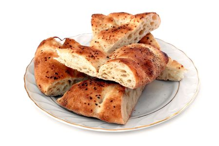 nigella seeds: Bread plate with full of sliced  pitas