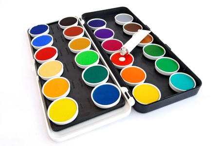 Water-color box with paint tube on white background photo