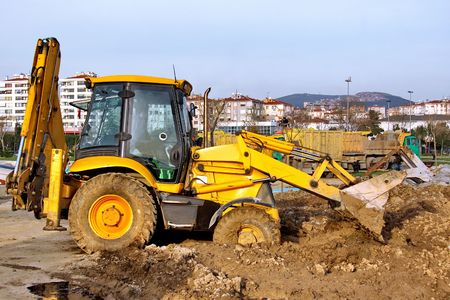 Construction Heavy Equipment - working in mud  Stock Photo - 4672251