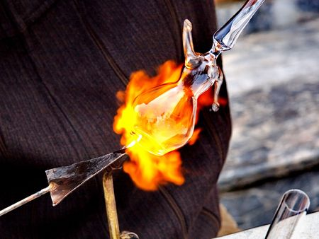 glassblower: Forming glass in to whirling dervish ornament Stock Photo