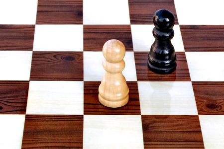 Adversary pawn chess pieces on a game board photo