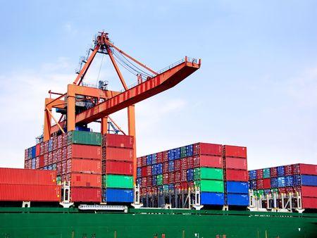 Container stacks under crane bridge