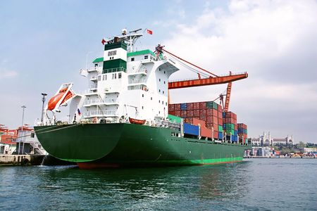 freeport: Green container ship Stock Photo