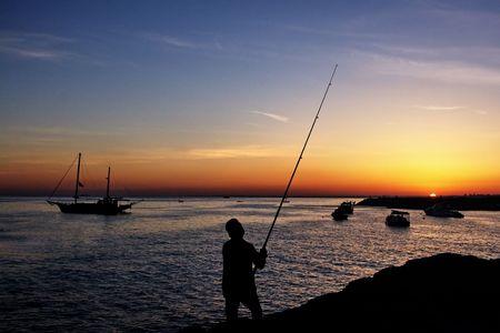 Fisherman by sunset photo