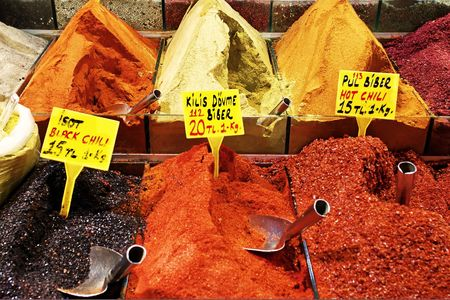 Chili pepper heaps on sale at spice market photo