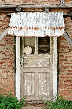 Brick wall and closed door. Abandoned house detail Stock Photo - 6371733