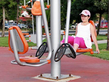 Girl exercising on exercise equipment photo