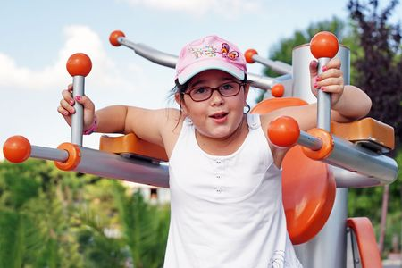 Child workout on exercise equipment