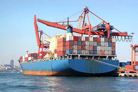 seaport: Fully loaded, blue cargo ship