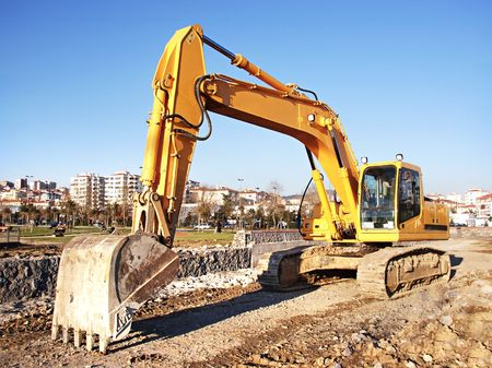 earth road: Excavator bulldozer at construction site