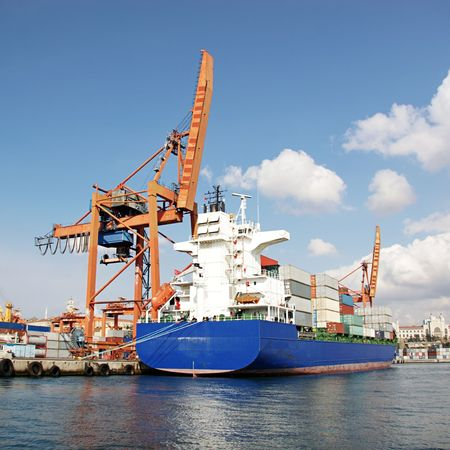 Harbor with blue container ship Stock Photo
