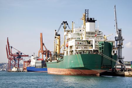 Trading port with cargo ships and cranes Stock Photo - 6789877